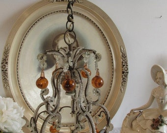 Gorgeous antique, vintage French macaroni beaded chandelier with glass drops.