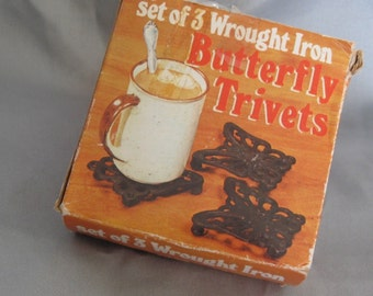Set of 3 wrought iron butterfly trivets with original box, 1978