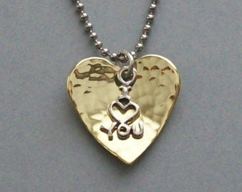 "I love you pendant necklace of a hammered and cupped brass heart with a sterling silver ""I (heart) you"" charm on chain of your choice."