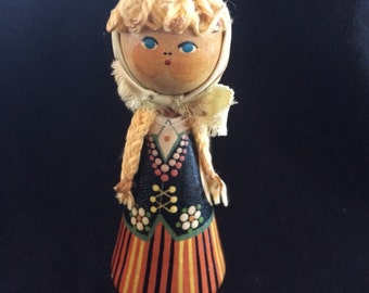 Wooden peasant girl figurine