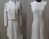 20% OFF as marked Clearance Markdown: Vintage 1960s Felicia 2 piece off white and silver dress with short bolero style jacket