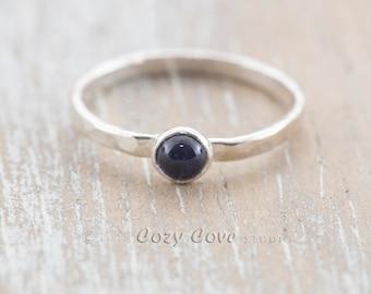 R319 Handmade violet-blue iolite ring in tarnish resistant Argentium ® sterling silver.