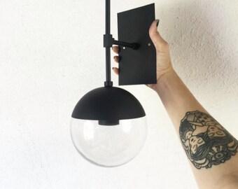 E A S T • modern matte flat black and brass light with glass globe