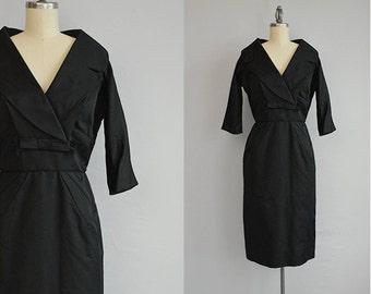 Vintage 50s Dress / 1950s Black Silk Wiggle Dress with Wide Portrait Collar Bow / Ardanti LBD