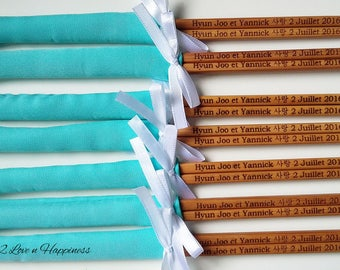 Customised engraved chopsticks in fabric sleeves and ribbons/ Korean characters & French wordings (min 20 pairs)