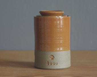 Pet memorial urn with lid. Handmade pottery pet urn or human ashes urn. Sand, rust orange with paw shown. cremation urn for ashes.
