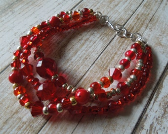 Ruby red and silver multi strand bracelet