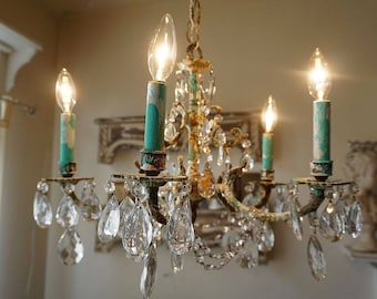 Rusty chandelier lighting hand painted Caribbean aqua blue w/ white crystals drops w/ garland ceiling light home decor anita spero design