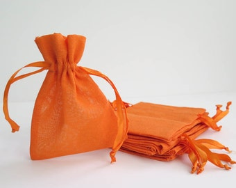 """Orange Cotton Muslin Bags 