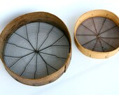 Antique pair of wooden sieves