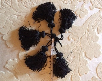 Six Black Silk Tassels
