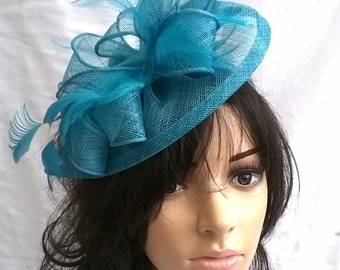 Turquoise Feather Fascinator on a headband..Sinamay & feather teardrop style.wedding ,races.