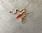 Lovely tiny 14 kt gold snake charm/pendent