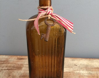 Bottle amber glass vintag, rustic vase with rusty key, collectors industrial decoration, antique bottle