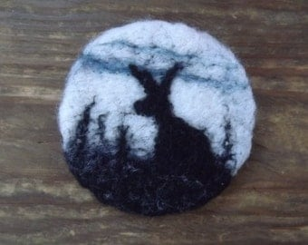 Needle Felted Brooch with hare in a field.  Hare Fibre Art. Hare Felted Art.