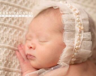 Hand stitched pearl newborn bonnet
