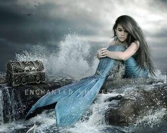 fantasy mermaid with blkue tail sits on ocean rocks art print