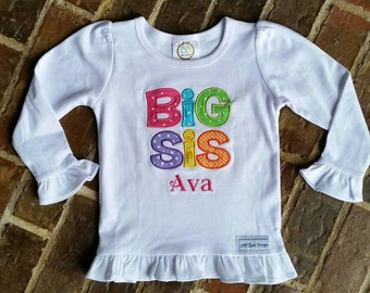 "Girl's ""Big Sis"" appliquéd ruffled shirt with embroidered name"