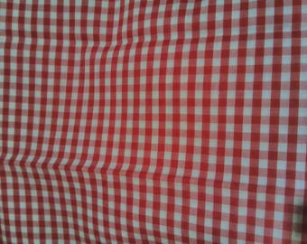 Approximately 3 yards red and white gingham fabric.