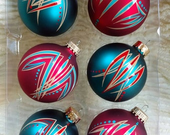Set of six 2.65 in glass ornaments, three satin red and three satin dark turquoise. Beautiful traditional pinstriping in red, tan and turquo