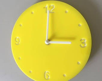 """Round Yellow & White Clock - White Acrylic Back, Yellow Finish Acrylic with White hands, Silent Sweep Movement. Sizes 8"""" or 12"""""""