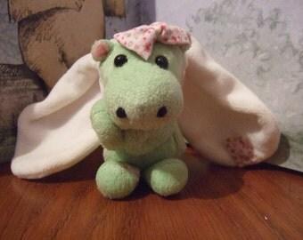 Plush dragon disguised as a rabbit