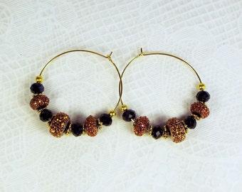 "Cynthia Lynn ""WILDFIRE"" Gold Tone Black Copper Crystal Beaded Hoop Earrings"