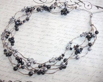Multi strand pearls crystal and silver tubes necklace