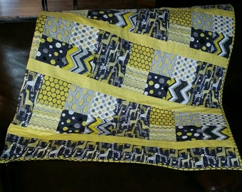 Gender neutral baby quilt  in greys and yellows featuring giraffe print by Michael Miller.