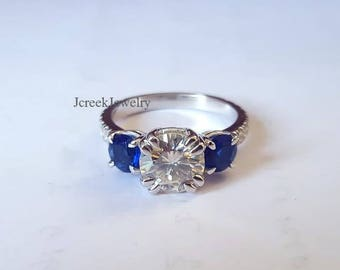 Ladies 2ct moissanite with sapphire and accents on the sides in sterling