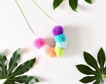 Pastel rainbow Pom pom necklace on pastel ombre cord