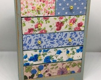 Handmade miniature dolls house furniture. Shabby chic style chest of drawers with patterned floral fabric fronts