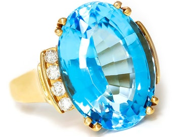 Oval Baby Swiss Blue Topaz Ring with Diamonds in 14kt Yellow Gold 15.25ctw