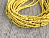 2-3mm Canary Yellow Coconut Shell Pucalet Rondelle Beads Dyed and Waxed 15 inch strand