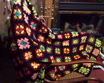 Hand made crocheted granny square afghan. Vintage. Very good condition. Free ship to US