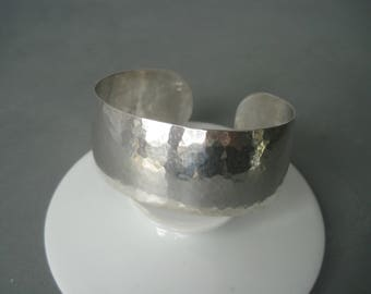 Massive vintage hand made hammered sterling silver bracelet.