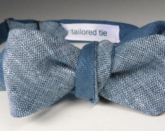Indigo chambray bowtie w/ dark & light hue premier finished yarn dyed flax threads… over aviation blue linen back blades. Slim adj self-tie.