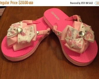 Pink ballerina over the top bow flip flops