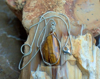 Tiger eye pendant free form silver wire wrapped with a silver plated necklace