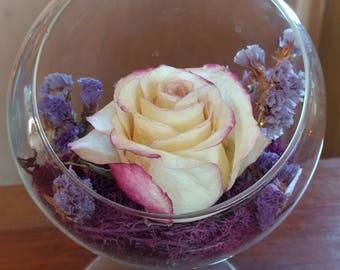 Standing glass globe floral arrangement