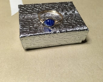 Cobalt blue swirl ring with box.