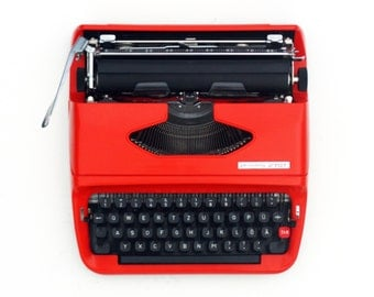 "Portable typewriter Orange 1970s futuristic font ""terminator"""