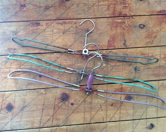 3 old Vintage Hangers Mid Century West Germany rusty foldable travelhangers iron textile
