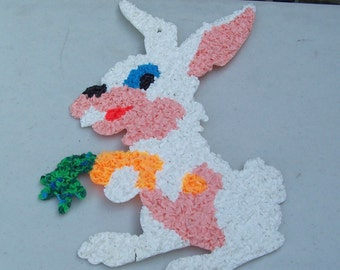Two vintage Easter bunny and carrot melted popcorn plastic decoration