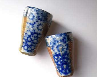 Moroccan tile tumbler, salt fired stoneware cup with silkscreen print, pottery pilsner, blue, white, tan. Zellij mosaic Moroccan pattern