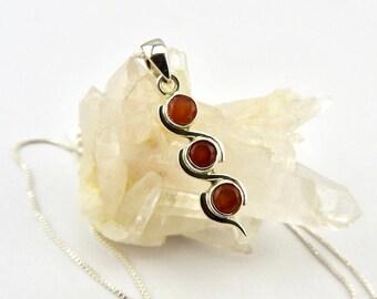 Carnelian pendant. Sterling silver. Carnelian. Jewelry. Jewellery. Gemstone pendant. Gemstone jewellery. Silver pendant. Silver jewellery.