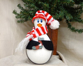 Hand painted and hand crafted gourd art Christmas penguin holding a stocking by Debbie Easley