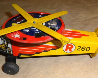"""1950s Spinning Helicopter. Tin Litho is all excellent. R260. 7"""" long."""