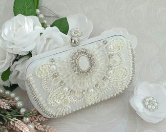 White Bridal Wedding Clutch Fashion.White wedding clutch of bride from satin embroidered with beads and sequins