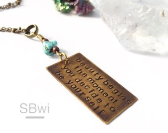 Coco Chanel quote necklace in bronze with turquoise detail